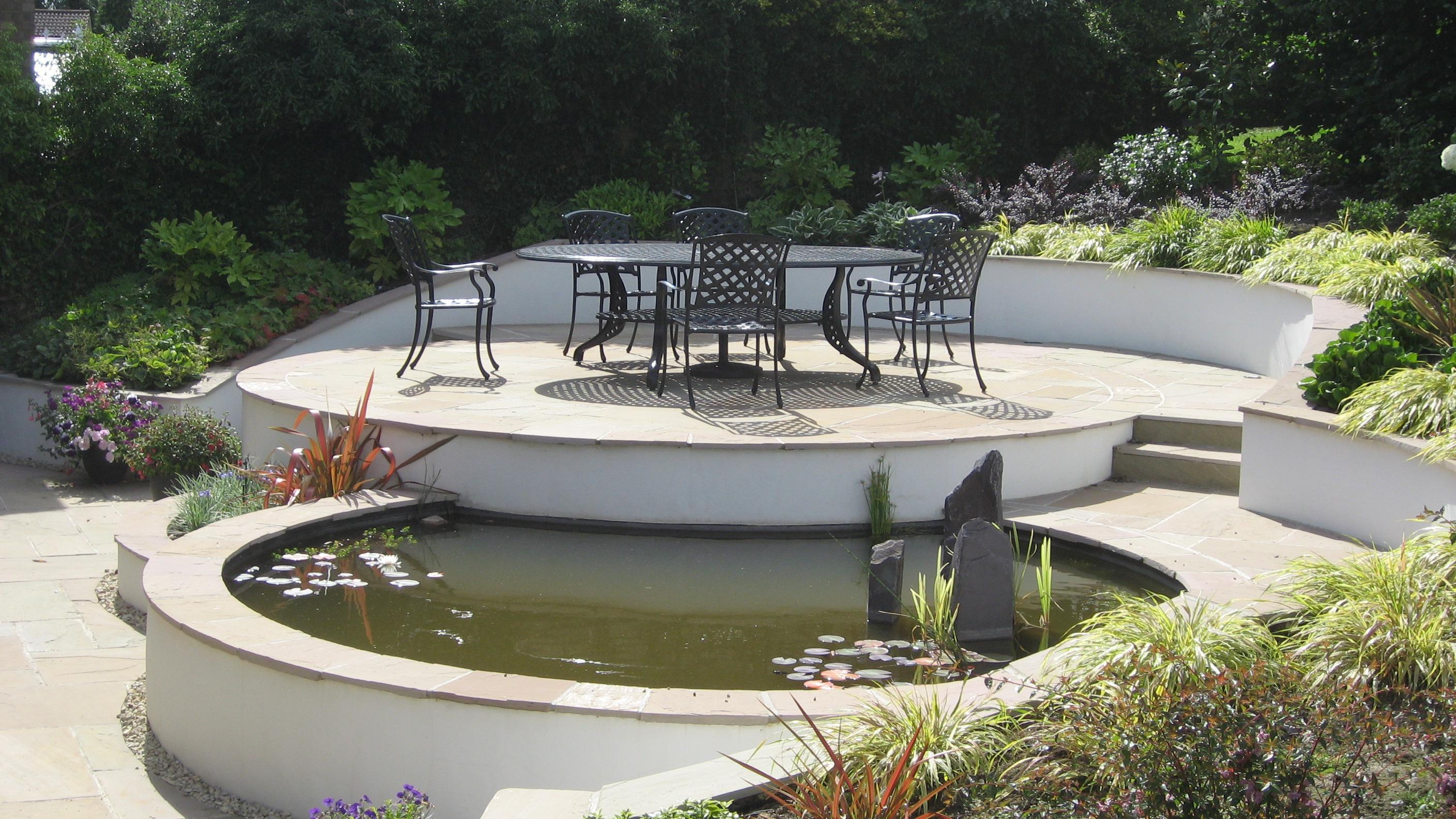 Sloping garden design accent garden designs for Modern fish pond design